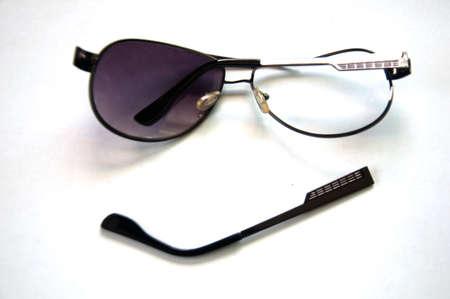 mangy: Broken sunglasses on white background Stock Photo
