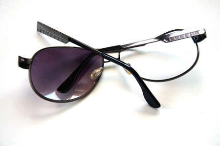 Broken sunglasses on white background Stock Photo