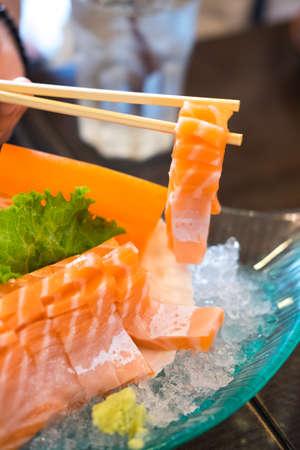 chop sticks: Sashimi with chop sticks Close up