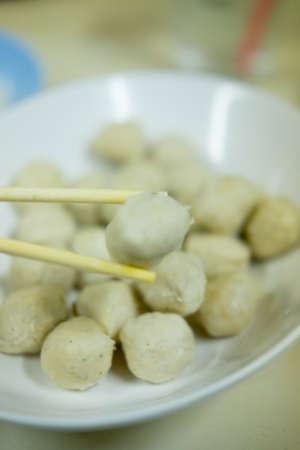 chop sticks: Meat ball pork with chop sticks Stock Photo