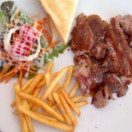 grill: Pork steak , vegetables and french fries