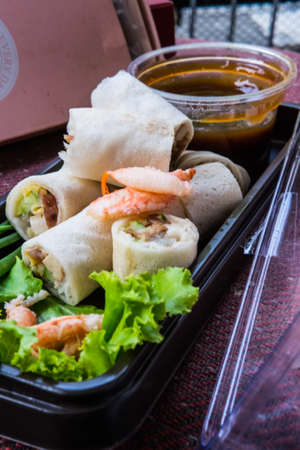 crab meat: Fresh spring noodle rolls with herbs, vegetable or crab meat, poured with sour Stock Photo