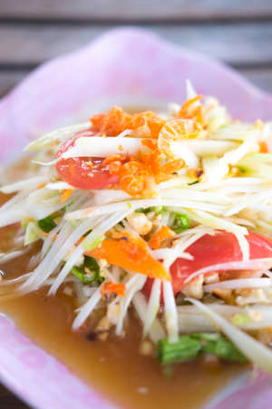 somtum: Somtum or Thai spicy papaya salad - Selective focus Stock Photo