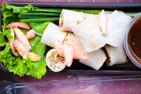 eaten: Fresh spring rolls, vegetables wrapped in dough, topped with crab meat and chili, eaten with sauce