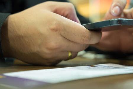 phone calls: Business Man pushing on mobile phone