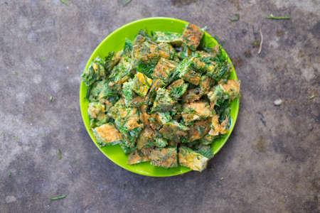 cha om: Thai Cuisine; cha-om omelet in green plate