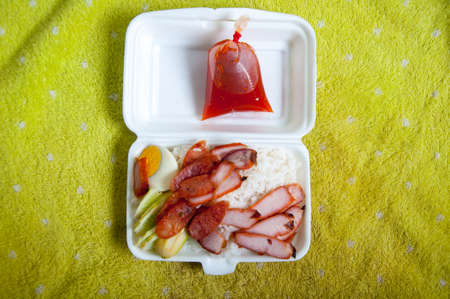 foam box: Crispy roasted belly pork chinese style and rice in foam box