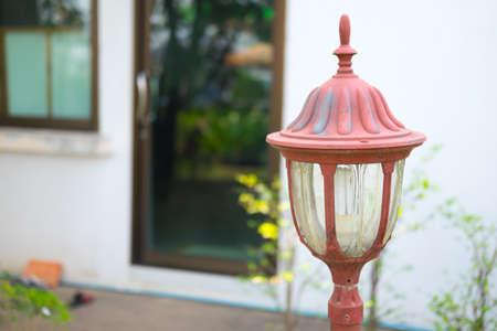 ironwork: Old Lamp in the summer garden Stock Photo