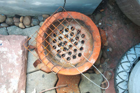 evaporating: Thai stove, cooking tool. Traditional charcoal burning clay stove