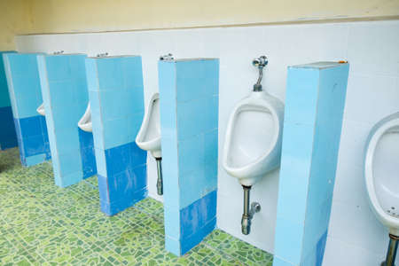 chrome man: urinals in an old building for men only Stock Photo