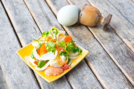 cleave: Spicy salad with salted eggs on yellow dish Stock Photo