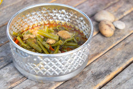tiffin: Pork curry with water spinach (Tae-pho soup) in tiffin carrier