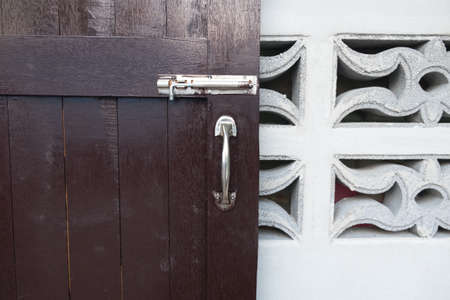 burnished: latch on a wooden door