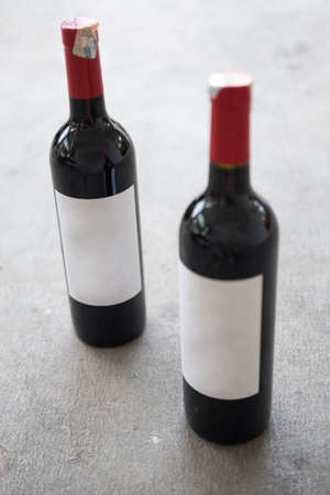 zinfandel: Red wine bottle, with real paper blank label Stock Photo