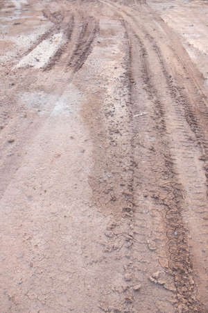 loamy: deep ruts of automobile wheels in loamy soil of country road