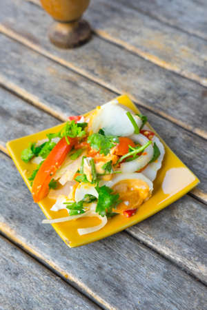 cleave: salted eggs salad on yellow dish