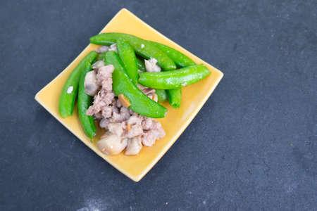 snap: Stir fry sugar snap peas with pork on black wood