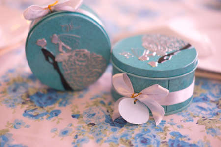 favours: box with paper tags on table gift from wedding ceremony