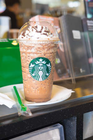 starbucks coffee: Samutprakarn, Thailand - May 21, 2016: Glass of Starbuck coffee ice cappuccino blended beverages served on table at starbucks coffee shop inside Home Pro Village , Suvarnabhumi shopping mall Editorial