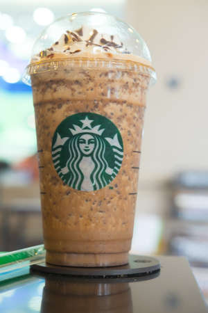 Samutprakarn, Thailand - May 21, 2016: Glass of Starbuck coffee ice cappuccino blended beverages served on table at starbucks coffee shop inside Home Pro Village , Suvarnabhumi shopping mall Editorial