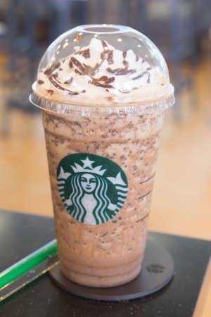 samutprakarn: Samutprakarn, Thailand - May 21, 2016: Glass of Starbuck coffee ice cappuccino blended beverages served on table at starbucks coffee shop inside Home Pro Village , Suvarnabhumi shopping mall Editorial