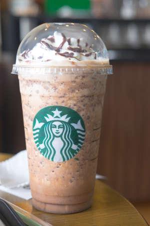 Samutprakarn, Thailand - May 21, 2016: Glass of Starbuck coffee java chip coffee frappuccino served on table at starbucks coffee shop inside Home Pro Village , Suvarnabhumi shopping mall Editorial