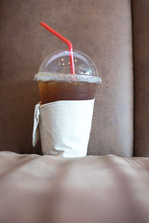 bash: Cold Ice coffee on sofa , Lifestyle of worker and student Stock Photo
