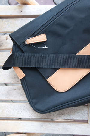 Messenger: New messenger bag on wood table