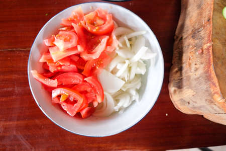 tomato slice: tomato slice and onion slice materials for cooking . Get ready for cooking Thai food. Stock Photo