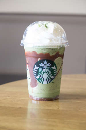 Samutprakarn, Thailand - June 18, 2016: New Double Chocolate Green Tea Frappuccino served at wood table in starbuck shop at department store