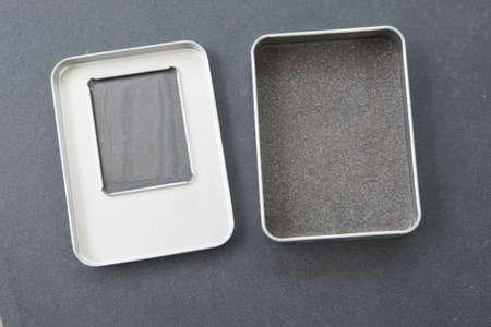 metal box: Open empty metal box on black background Stock Photo