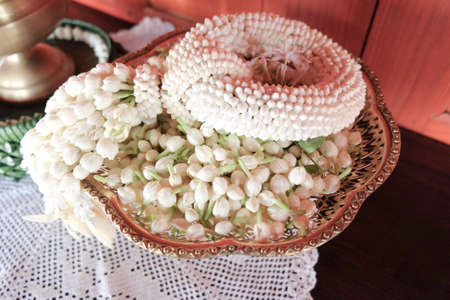 Jasmine garland flowers and using them in decorations, which are different from other places. Thai garlands called Phuang Malai Stock Photo