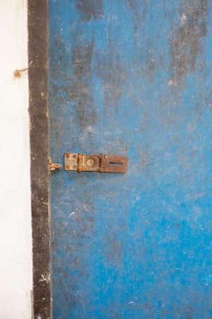 blue door: ancient blue door with iron door locked Stock Photo