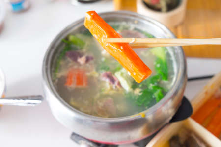 crab pot: use chopstick boiled crab sticks over shabu hot pot
