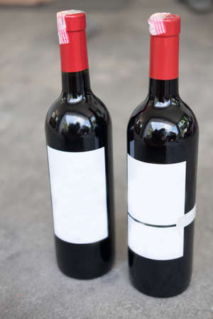 syrah: Red wine bottle with real paper blank label Stock Photo