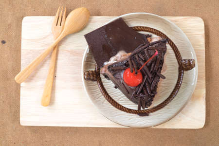 topping: Piece of chocolate cake with cherries topping Stock Photo