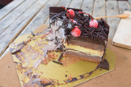 cake topping: Sweet chocolate cake topping with chocolate and cherries