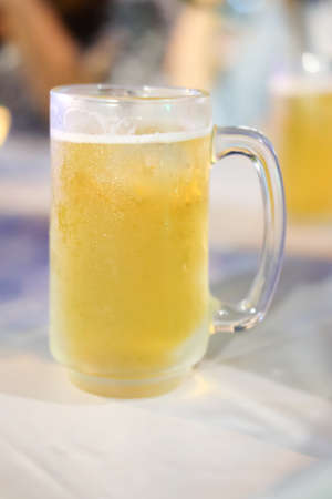 unbottled: Glass of beer close-up, Mug fresh beer with cup Stock Photo