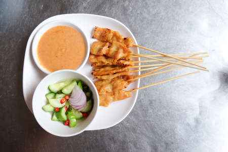 satay sauce: Pork satay,Grilled pork served with peanut sauce or sweet and sour sauce