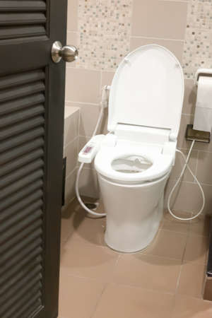 empty the bowel: Hygienic and high technology of the toilet bowl, automatic flush toilet Stock Photo