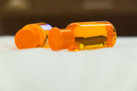 Orange shampoo, shower gel or bath foam in bottles
