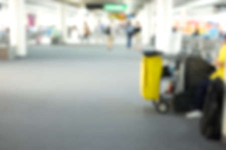 mopped: blur background of cleaning equipment in the airport