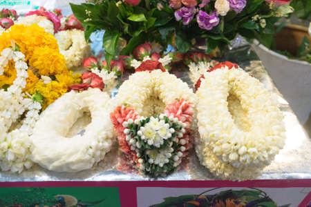 Flower garlands for buddha in the market,Thailand Stock Photo