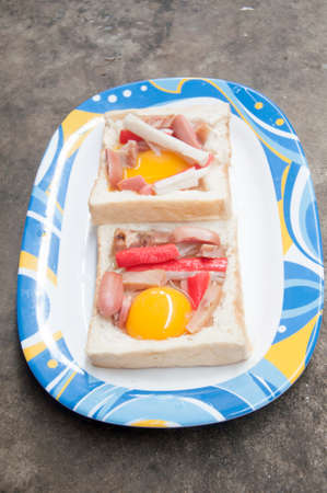 frog egg: Egg in a hole toast cut out sprinkled with crab stick and hotdog