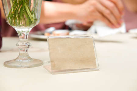 Blank frame on table in restaurant cafe shop