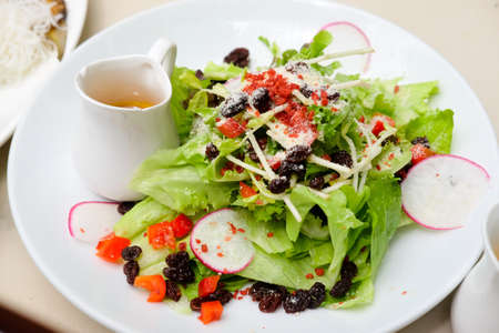 serving of healthy vegetables salad, healthy eating and lifestyle concept