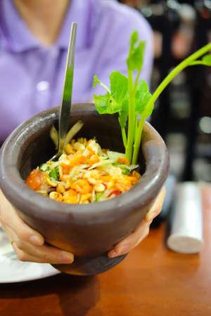 Papaya Salad - SomTum erved in mortar Stock Photo