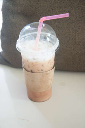 stone cold: Cold coffee on stone table at cafe. (soft focus)