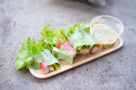 vegetable tray: Salad roll vegetable salad and salad dressing on wood tray Stock Photo