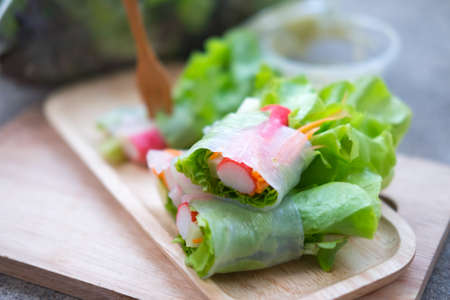 vegetable tray: Vegetable salad roll on wood tray, healthy food. Selective focus
